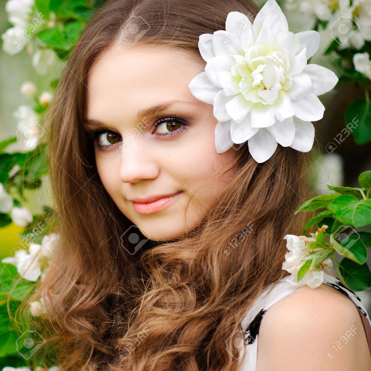 beautiful girl with a flower in her hair Stock Photo - 9810332