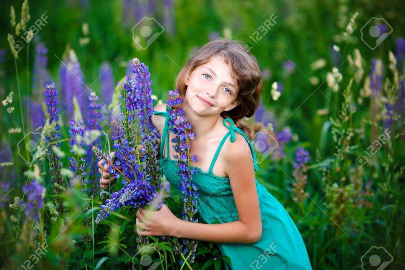 little girl in the field with flowers Stock Photo - 9811596