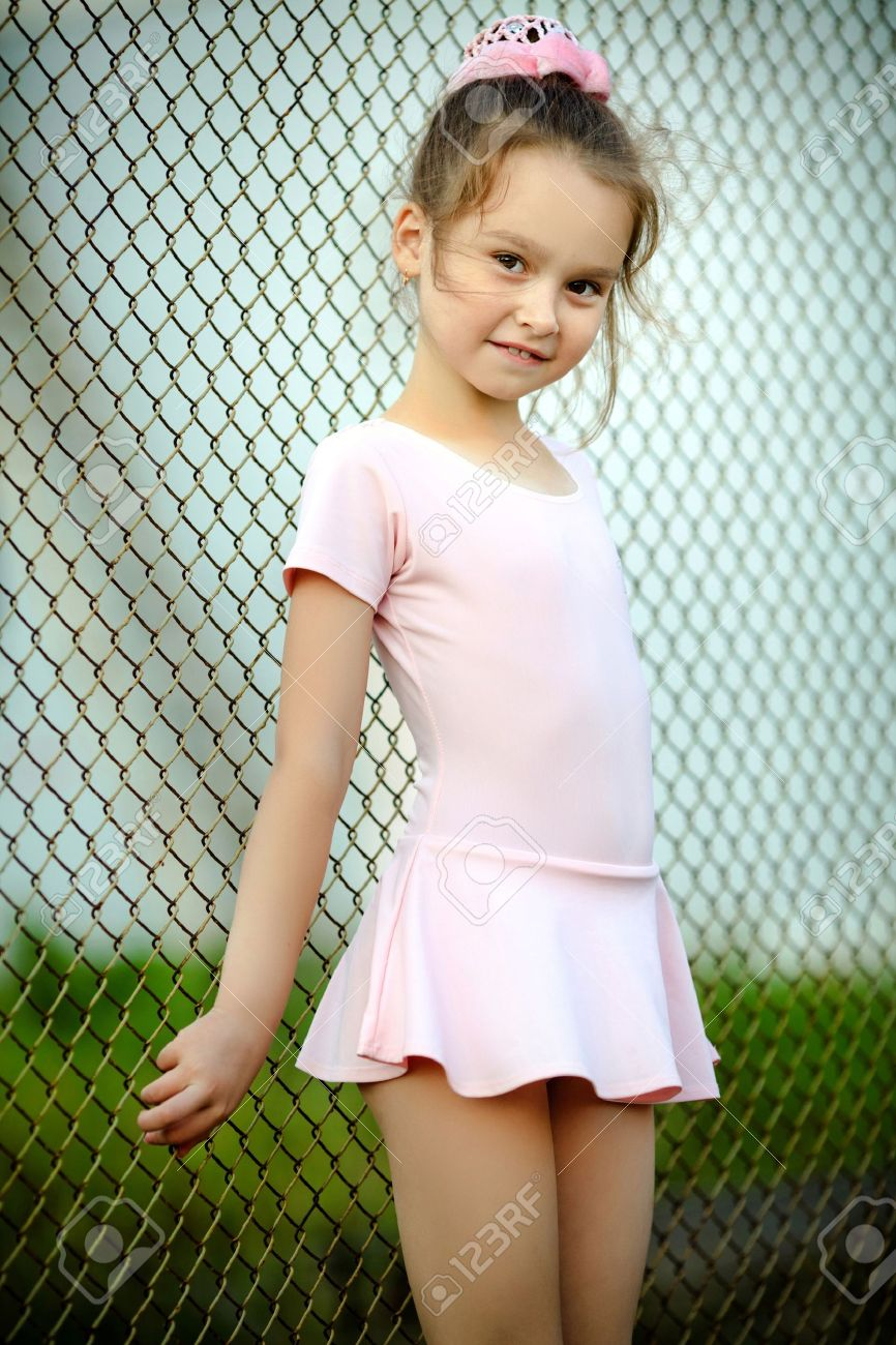 Young girls  little girl gymnastic: portrait of a young girl in a gym suit Stock Photo