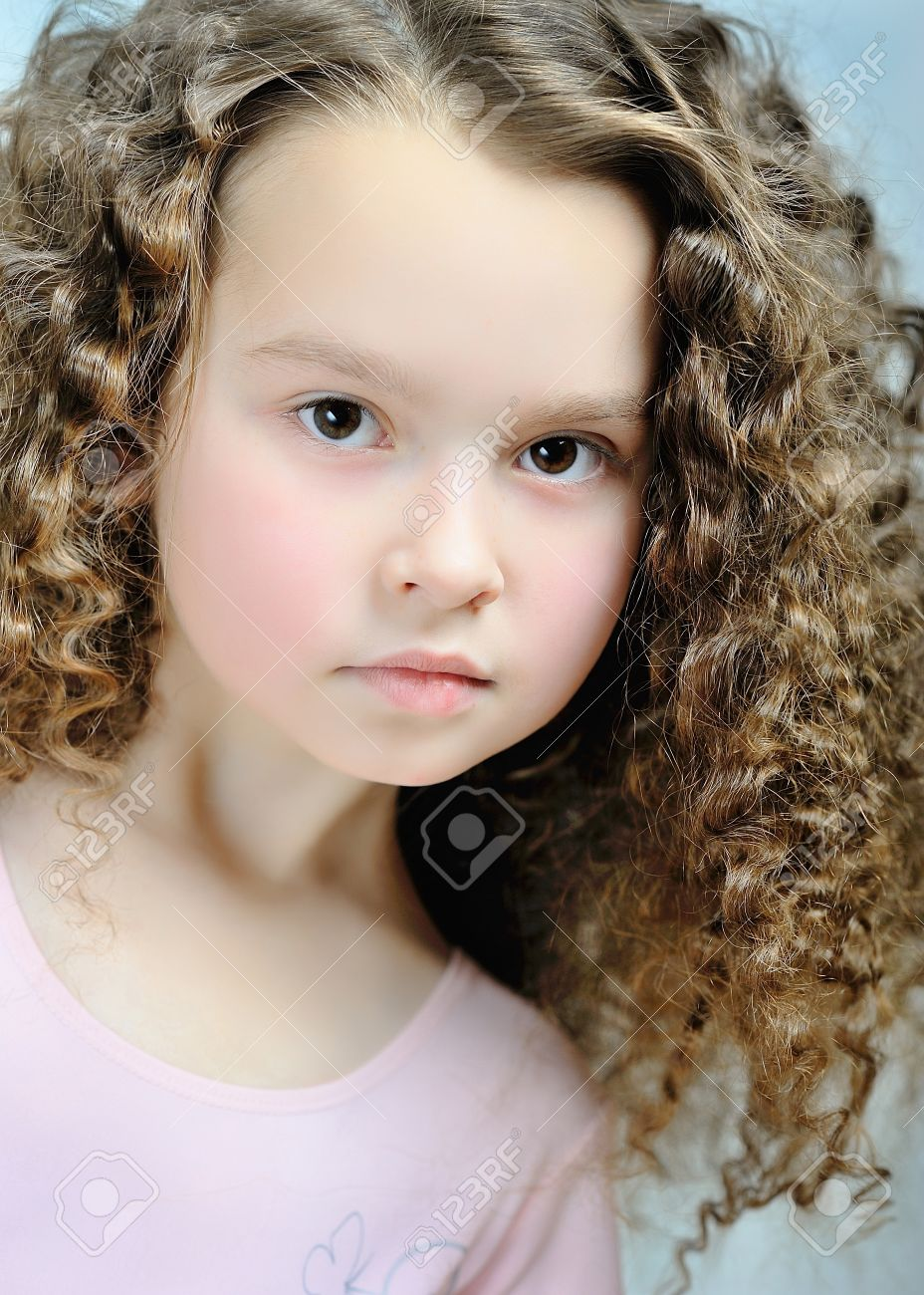 portrait of a beautiful little girl with curls Stock Photo - 12923001