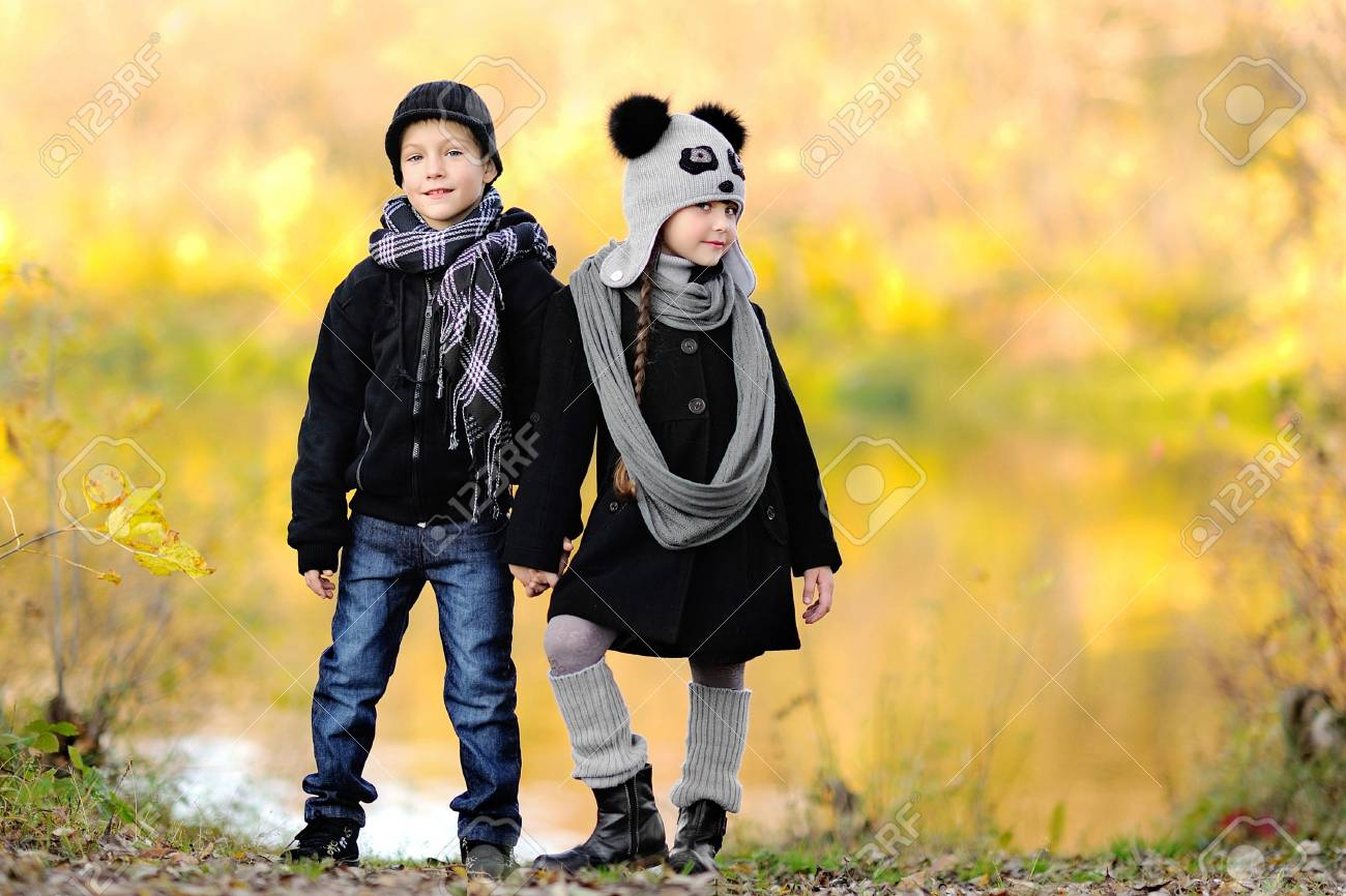 portrait of little boy and girl outdoors in autumn Stock Photo - 16335698