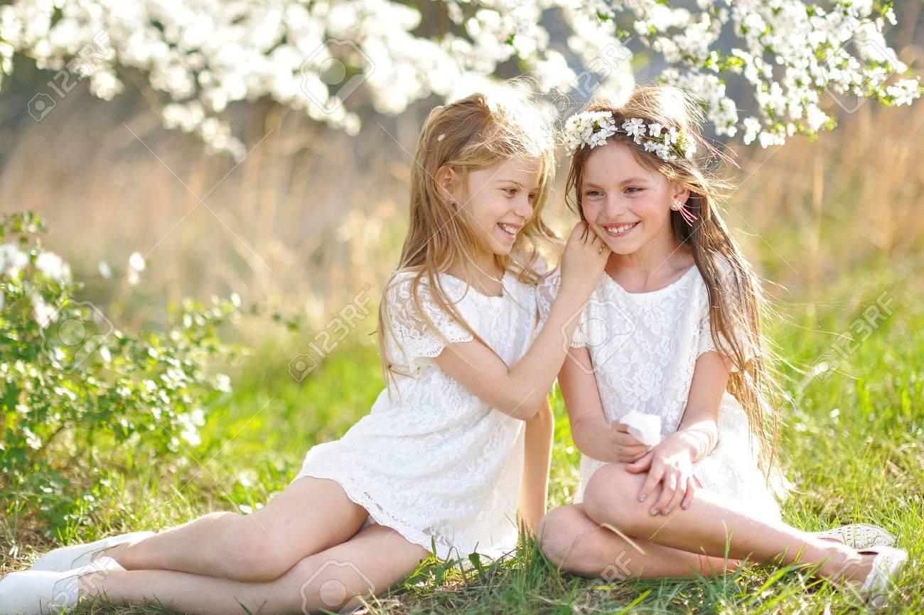 Portrait of two little girls girlfriends spring - 51750533