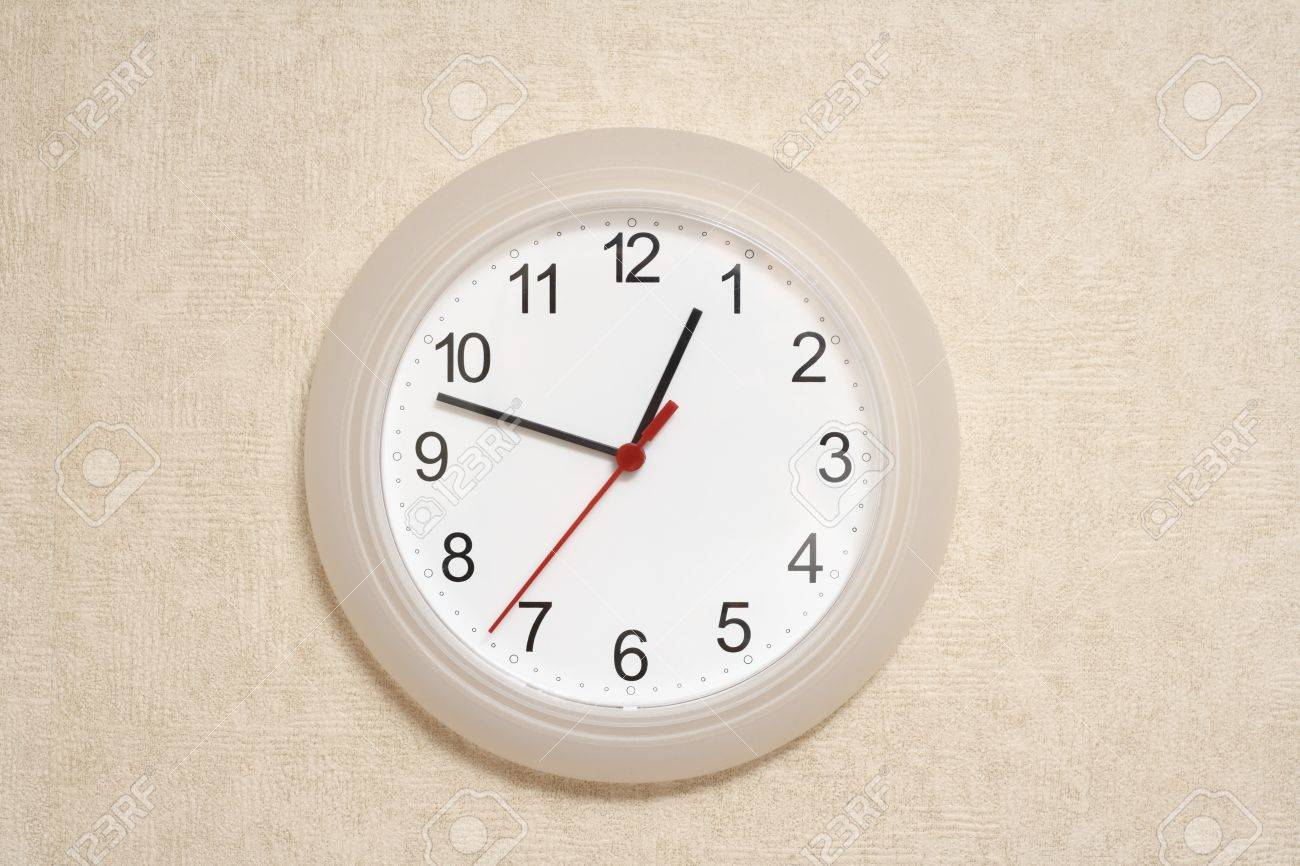Clock on the wall stock photo picture and royalty free image clock on the  wall stock