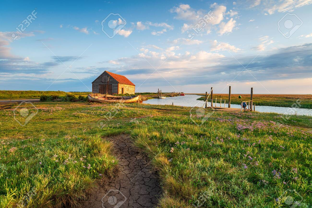 Summer at the old harbour in Thornham on the Norfolk coast - 130412429