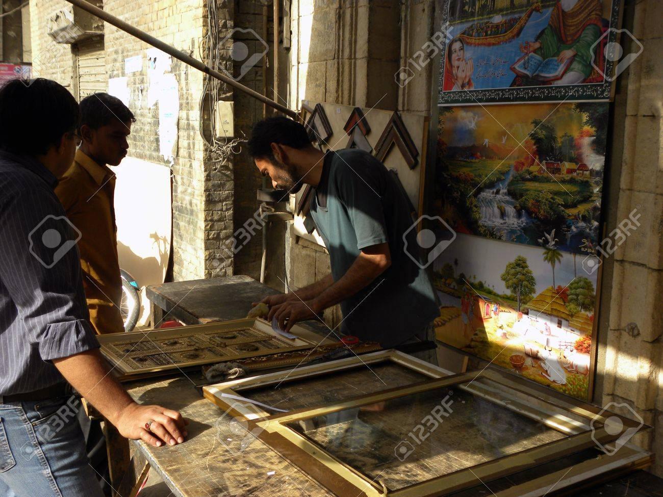 pakistankarachi_man making frames on artificial khana hai kaaba stock photo 12779294
