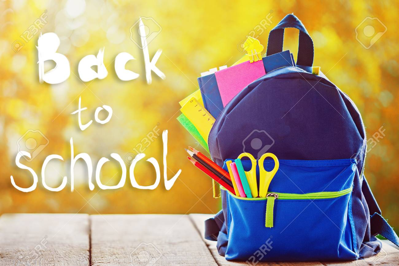 a1f46dae554 Full School backpack on autumn nature background with word back to school.  Stock Photo -