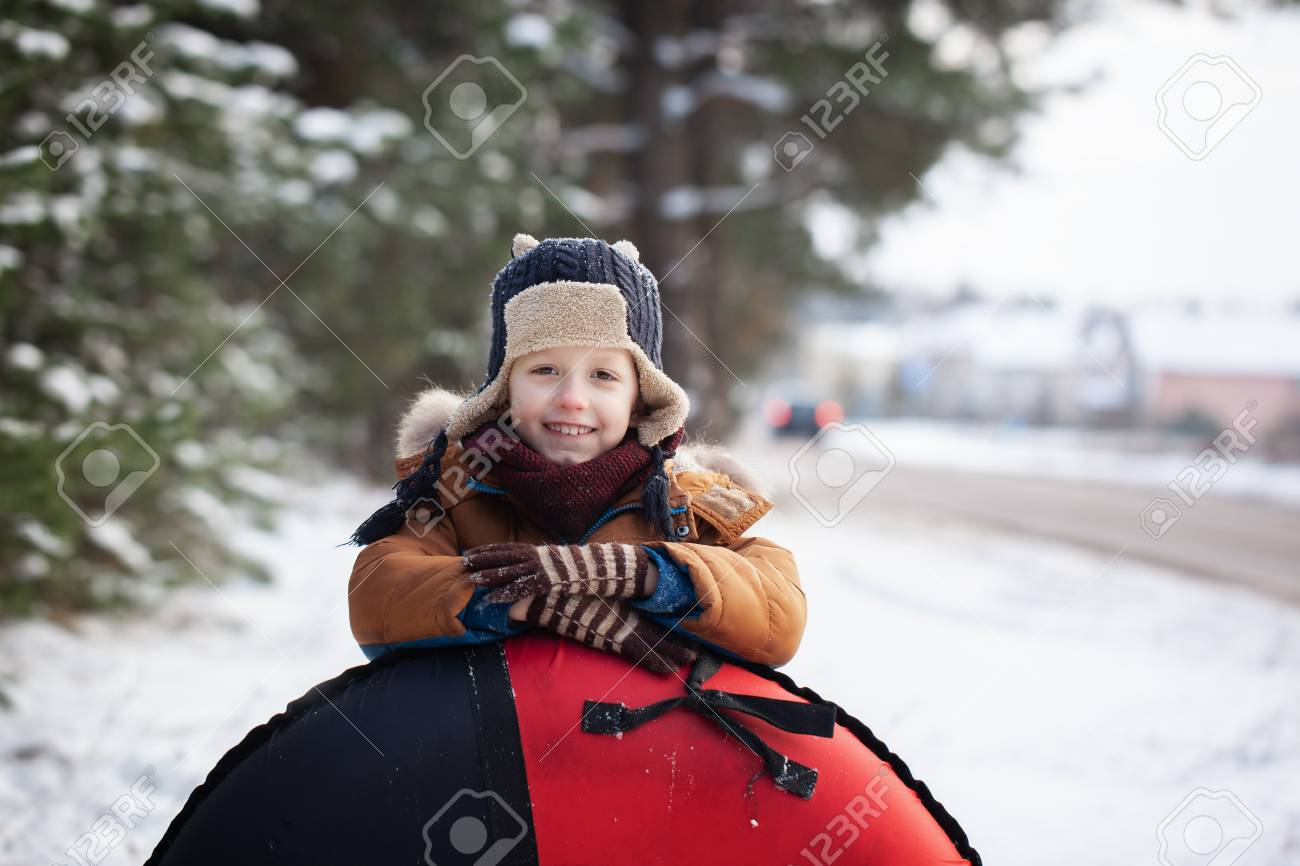 20e8df27a Portrait Little Baby With Tube In Winter Day. Cute Boy Play Outdoors ...