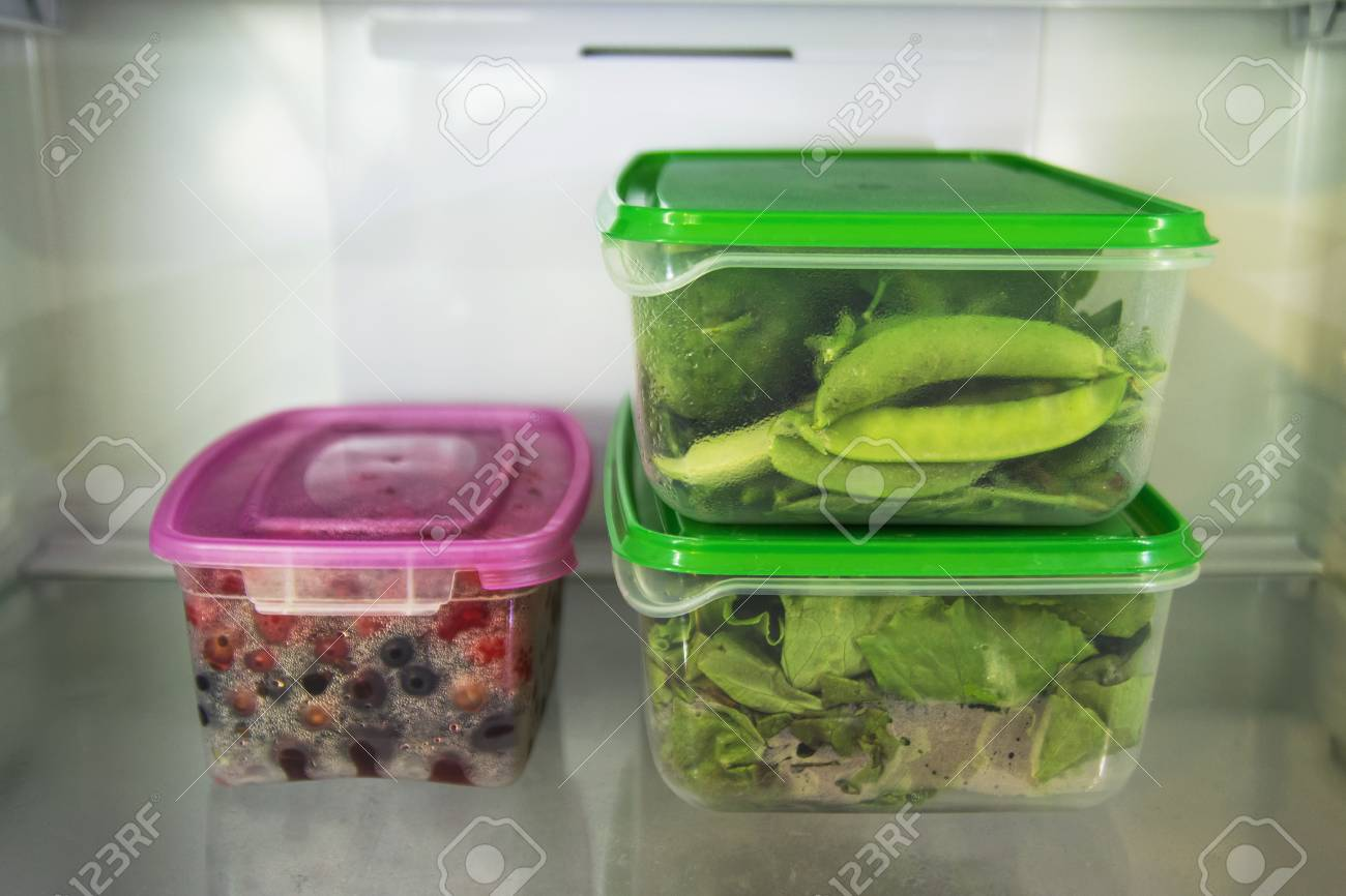 Two Plastic Food Containers With Green Vegetable salad Basil