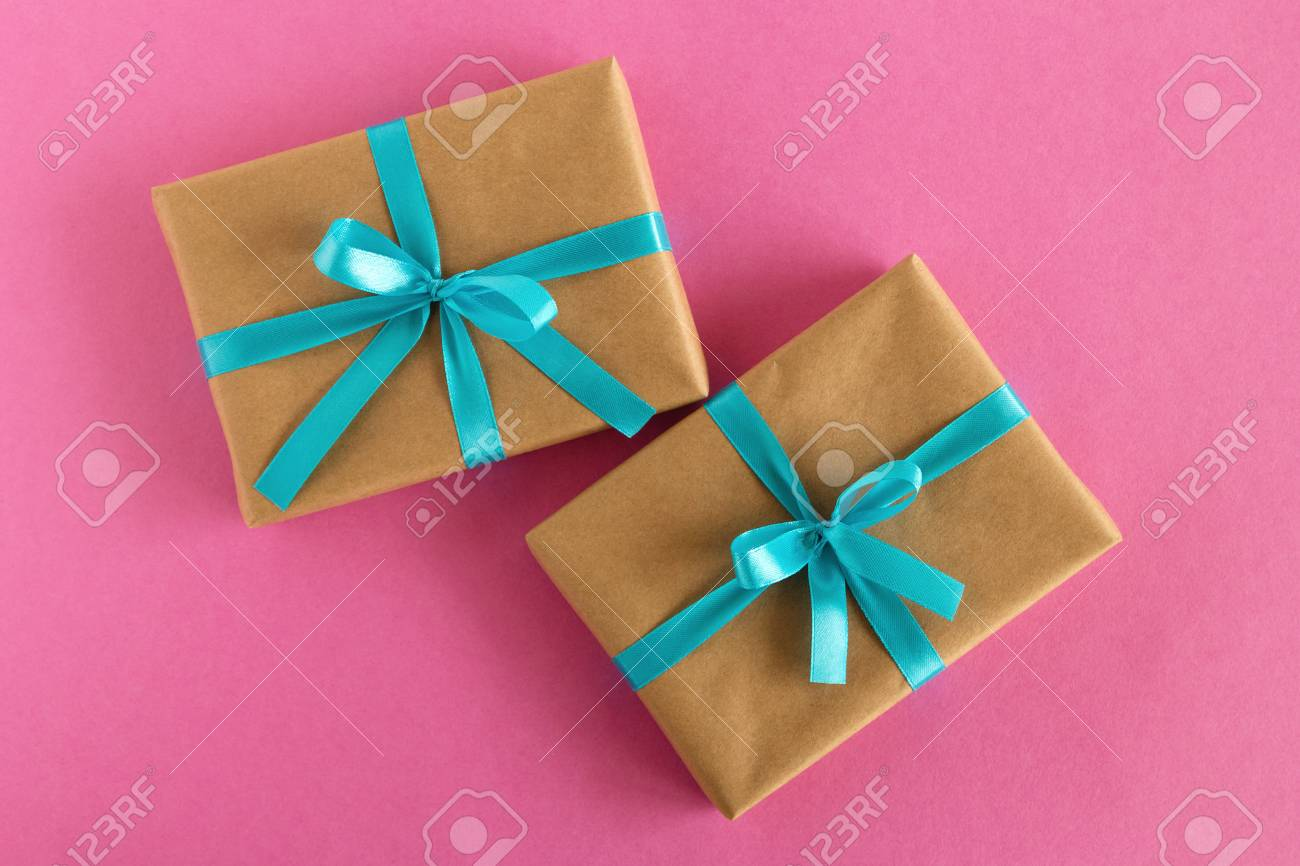 Two Gift Boxes Wrapped Of Craft Paper And Blue Ribbon On The.. Stock ...