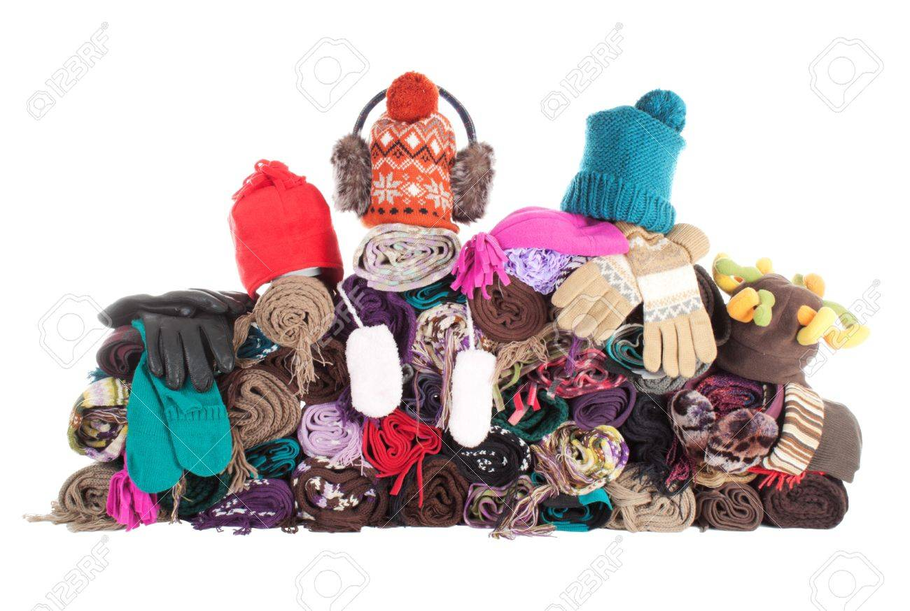 Huge pile of woolen winter scarfs, hats and gloves. Isolated over white Stock Photo - 8645842