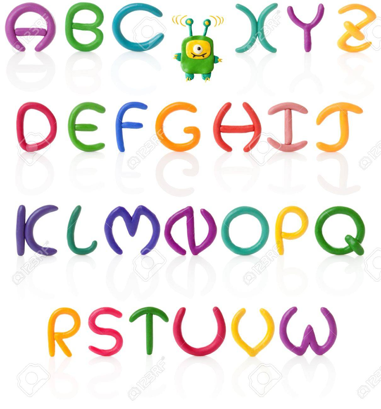 Colorful hand made and upper case letters with real reflections. Isolated over white Stock Photo - 9026889