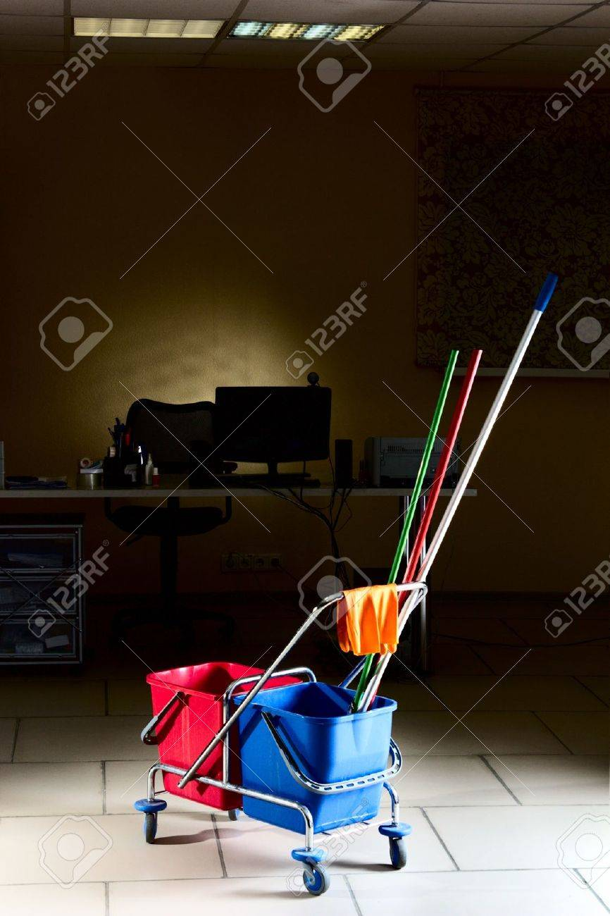 Trolley with water backets and cleaning stuff in the middle of the empty office Stock Photo - 11096197