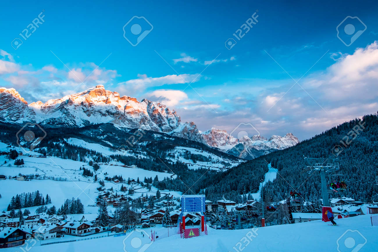 Sun goes down on an alpine valley in italy during a snowy winter - 169855960