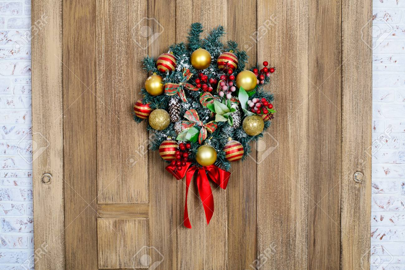 Beautiful And Expressive Christmas Wreath On The Door Stock Photo