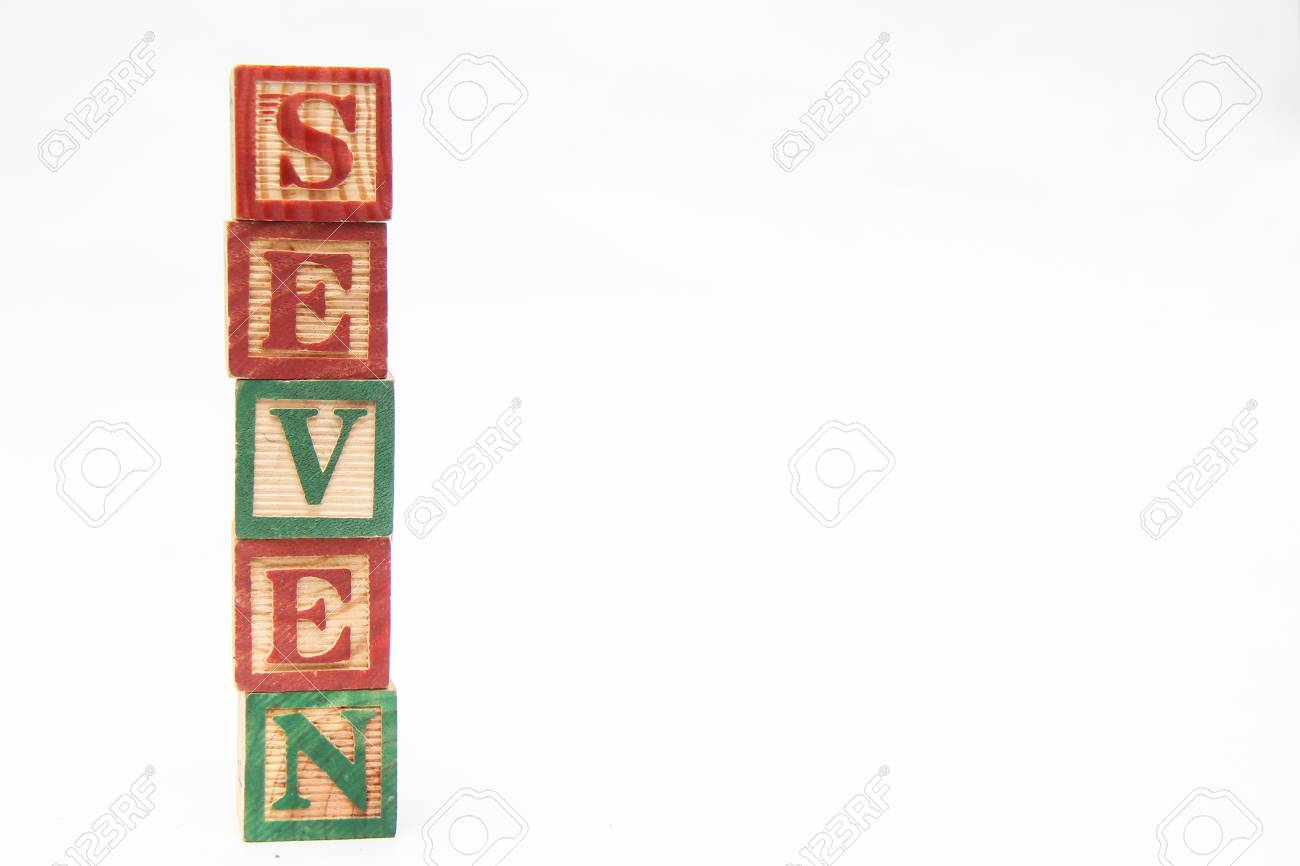 The Arrangement Of Letters Forms One Word Seven Stock Photo