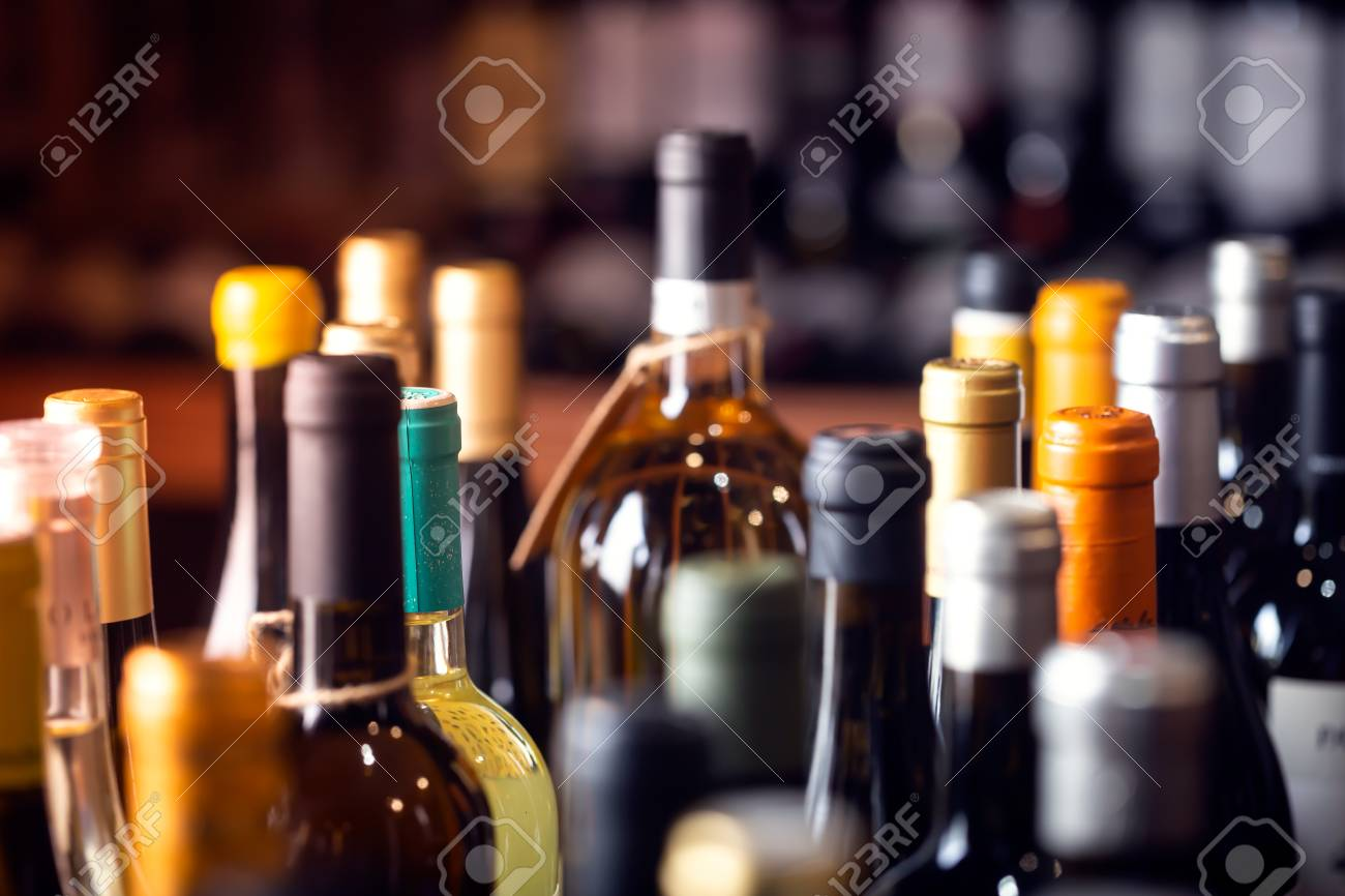 Bottles of wine on the shelves of an alcohol shop in Spain, Alicante. Background, horizontal orientation - 121311219
