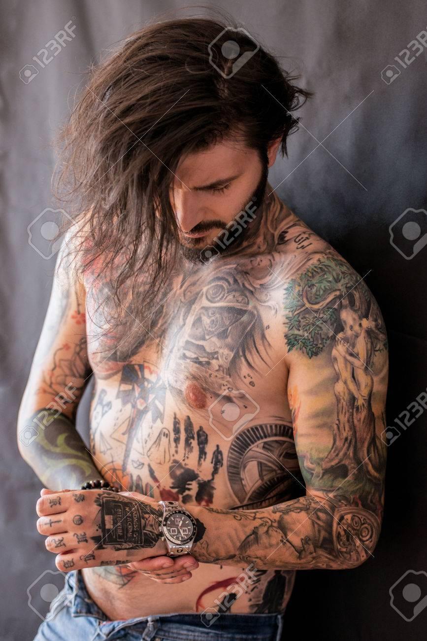 Naked man tattoo