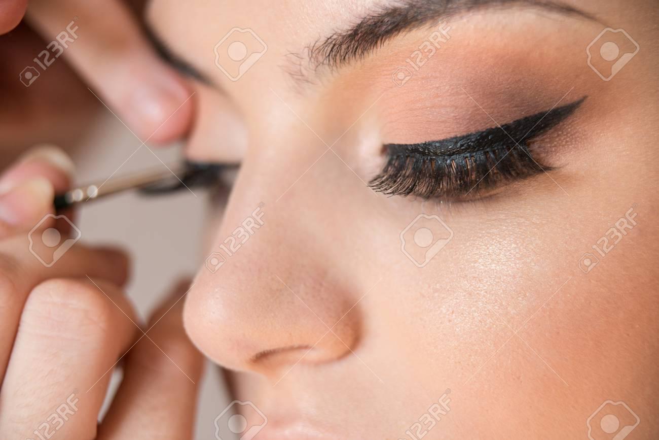 Macro Detail Of Caucasian Model False Eyelashes During Make Up