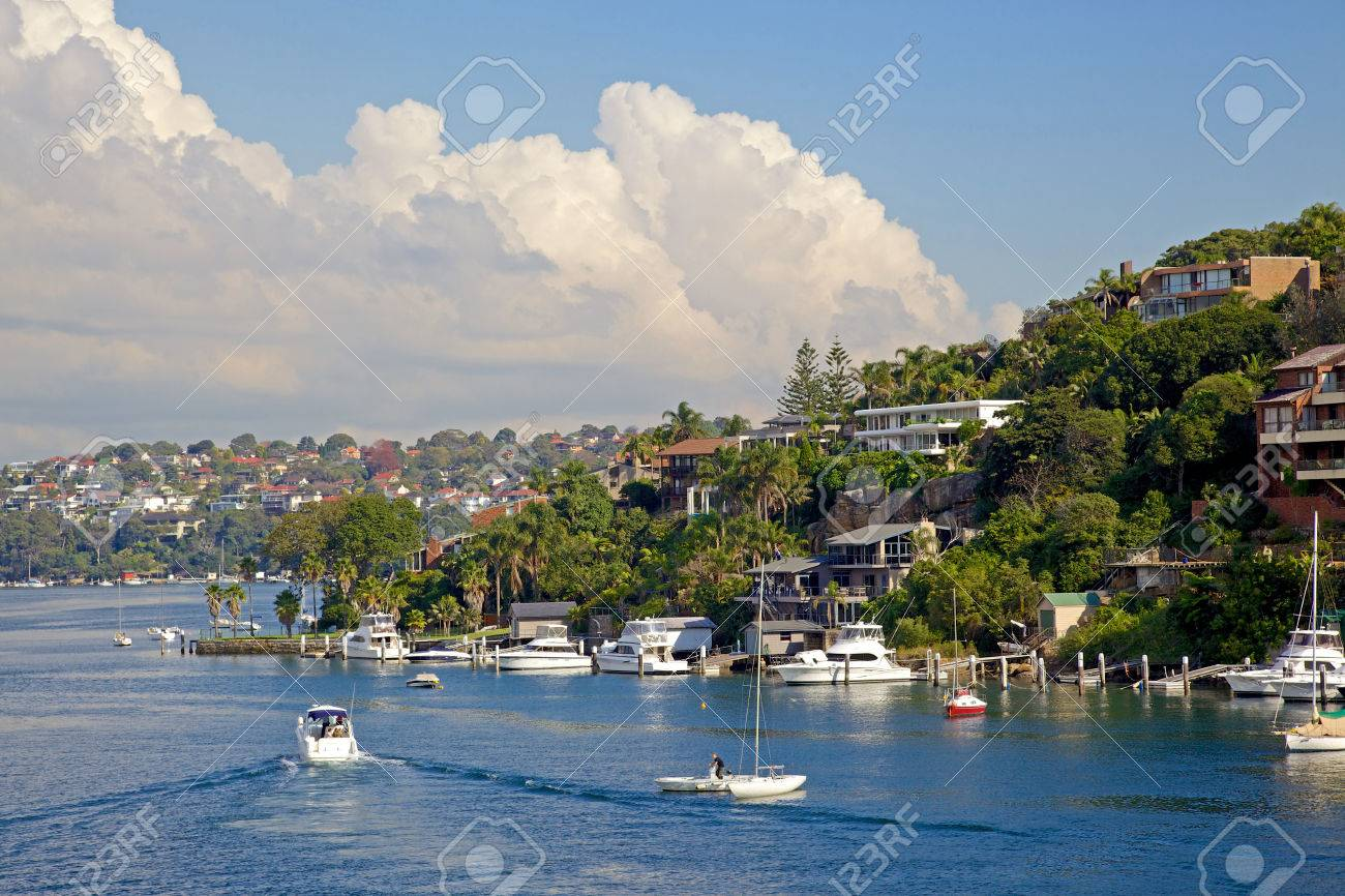 Cabin Cruisers moored at private jetties in front of houses in