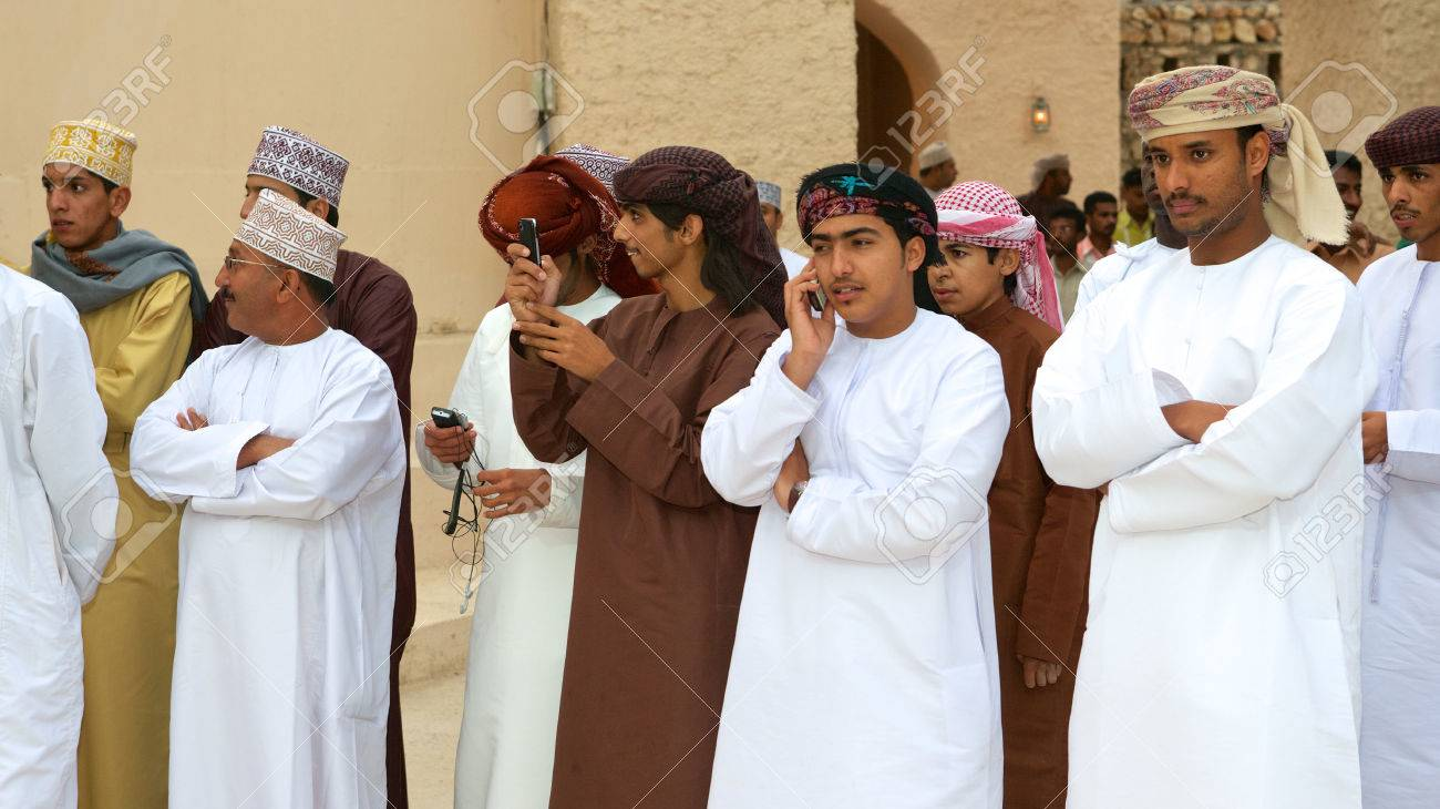 i men watching a tribal dance in muscat in the sultanate i men watching a tribal dance in muscat in the sultanate of stock