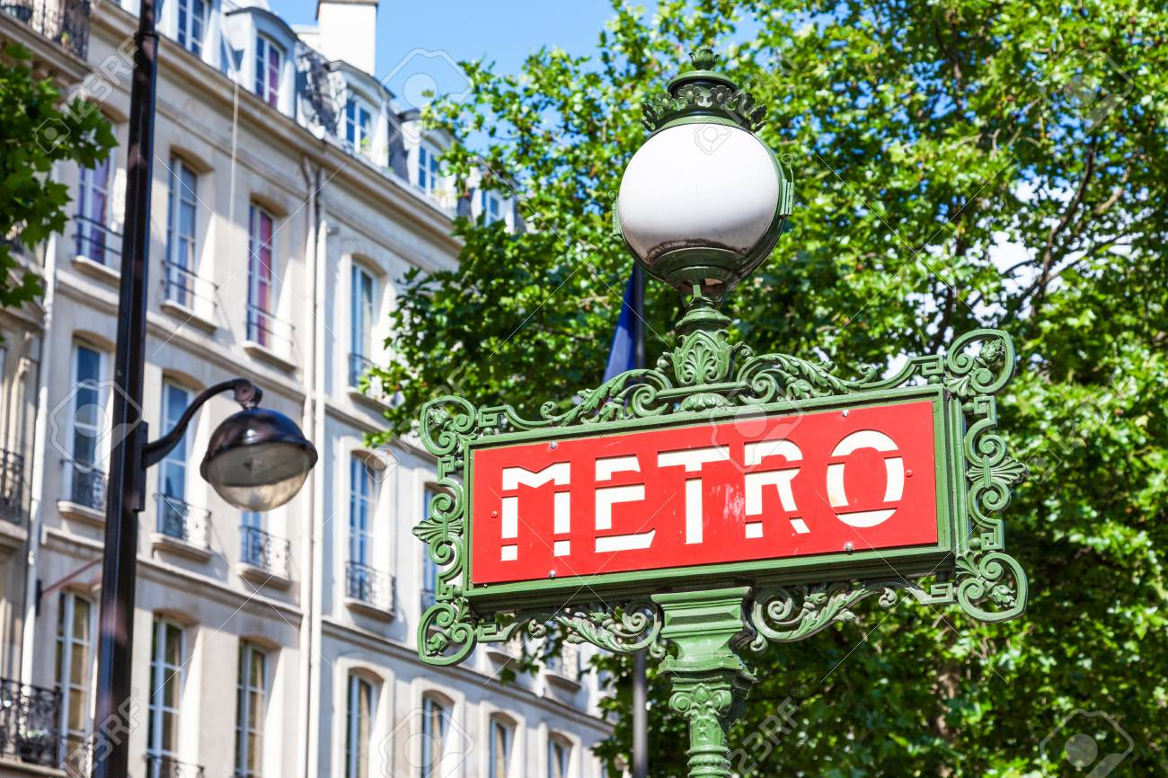 A Paris Metro Sign Crowned By A Spherical Lamp In The Art Nouveau ...