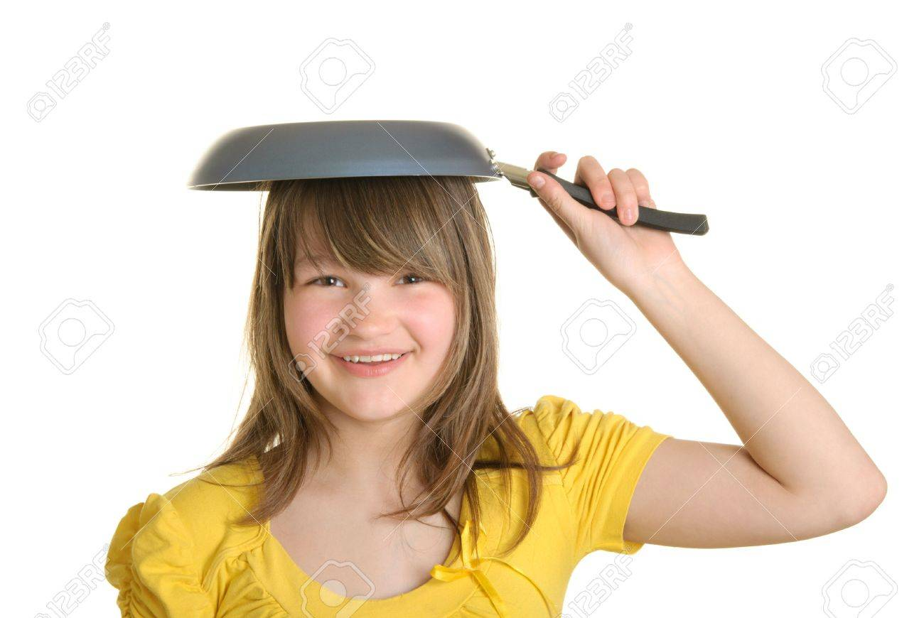 Girl holds frying pan on head and smiles isolated in white Stock Photo - 6929427