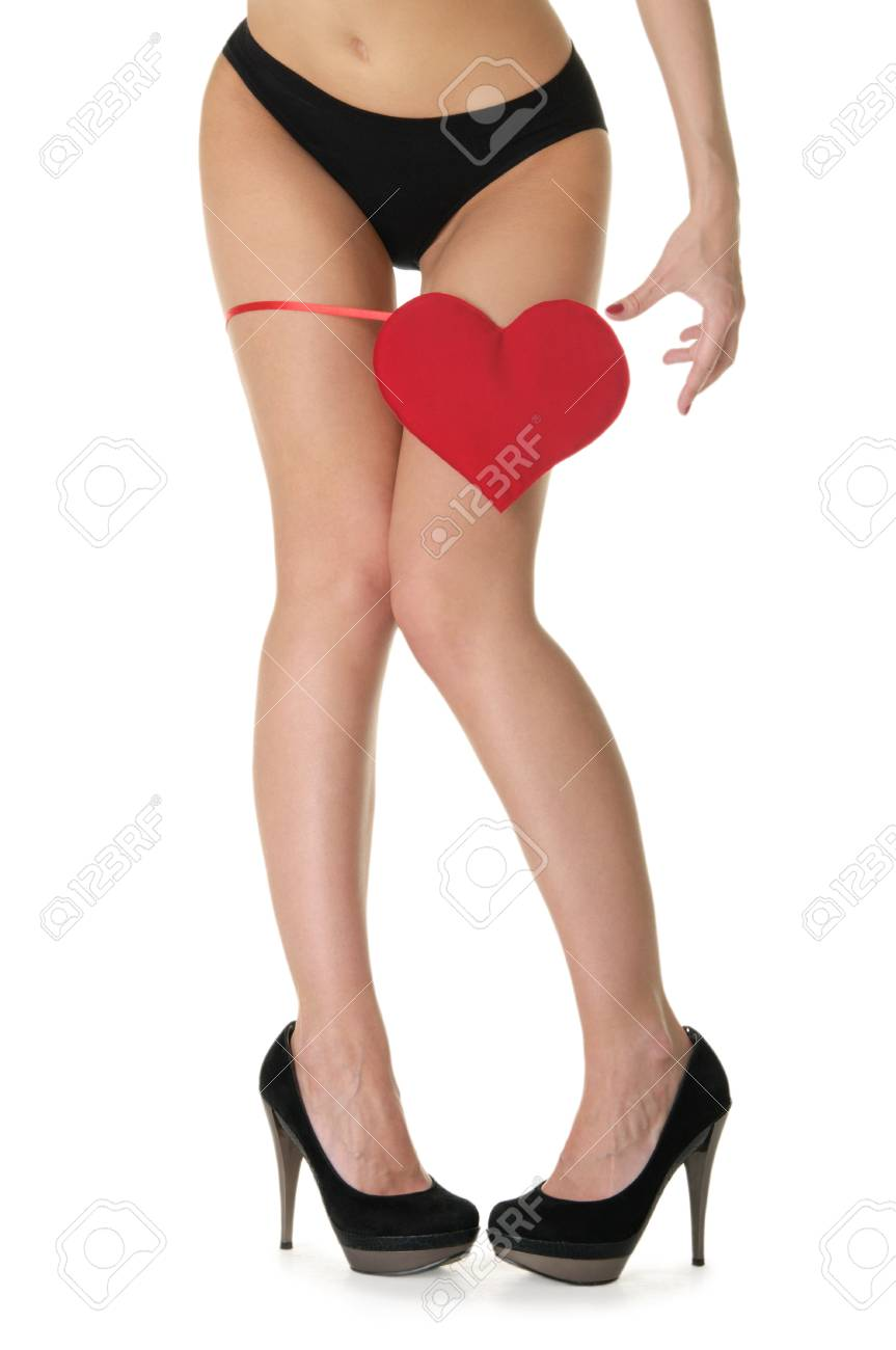 heart at the foot of woman in black lingerie Stock Photo - 9357602