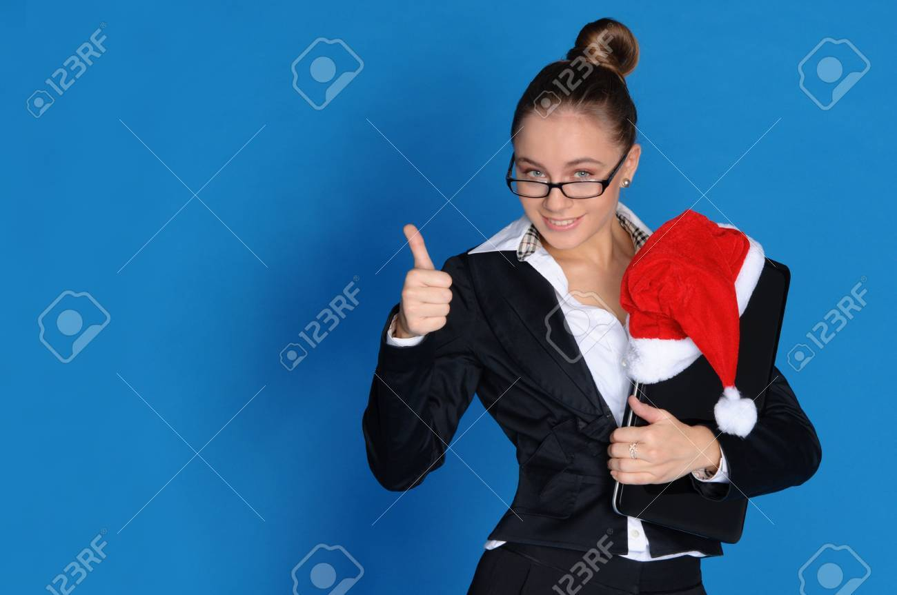 Happy businesswoman with laptop, Christmas hat Stock Photo - 11790441