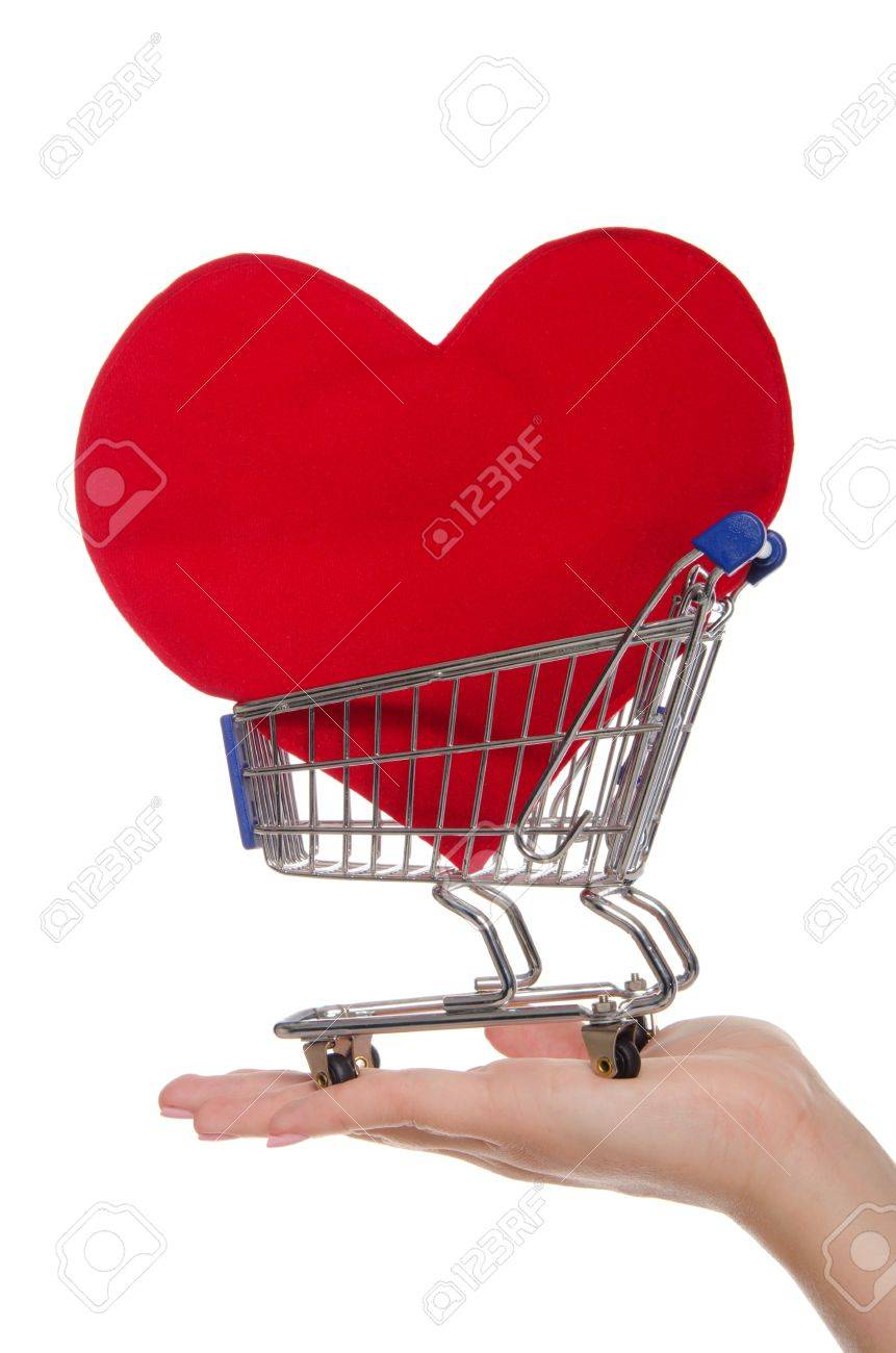 heart symbol in shopping trolley on the palm Stock Photo - 13199238