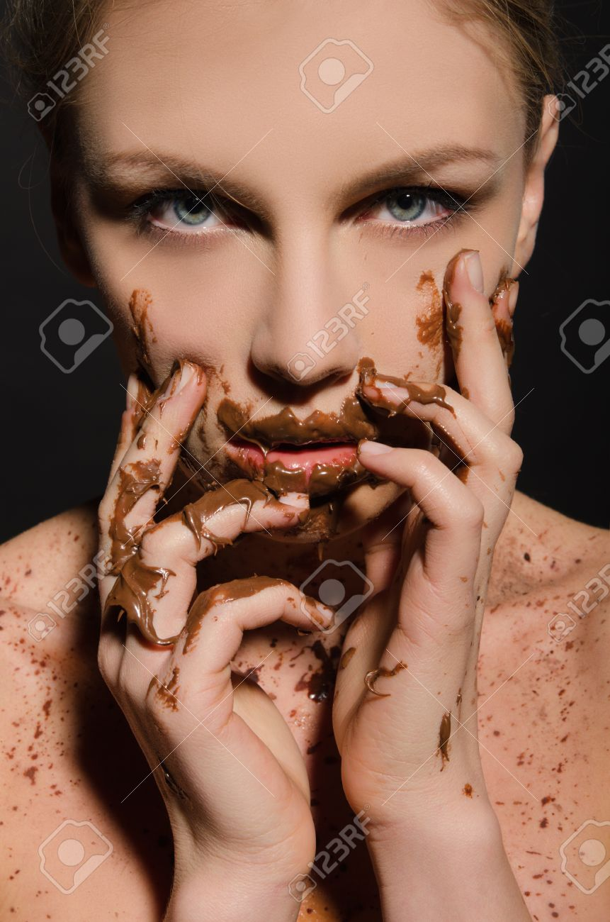 Beautiful Woman With Chocolate On Her Face On Dark Background ...