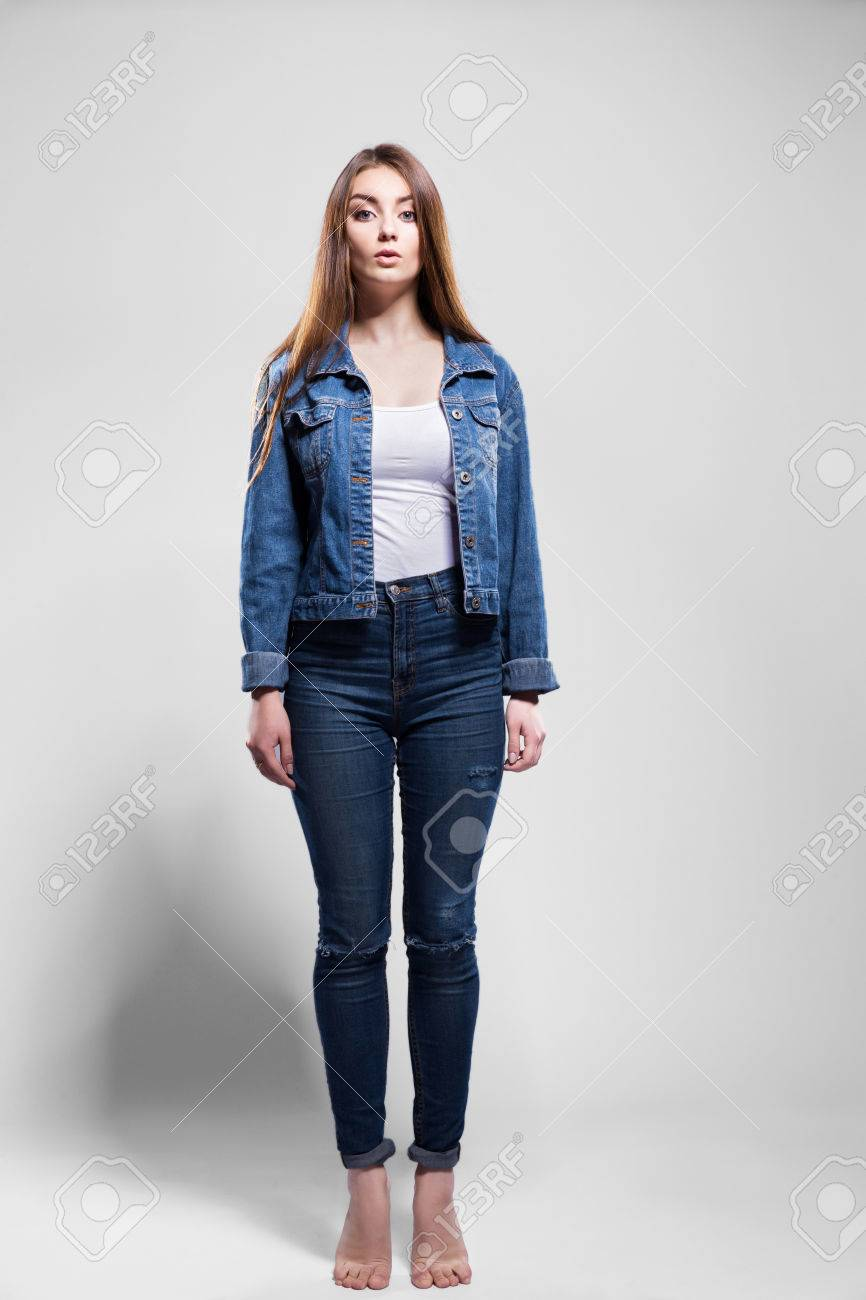Young Sexy Woman In Jeans Jacket White Shirt Jump Stock Photo