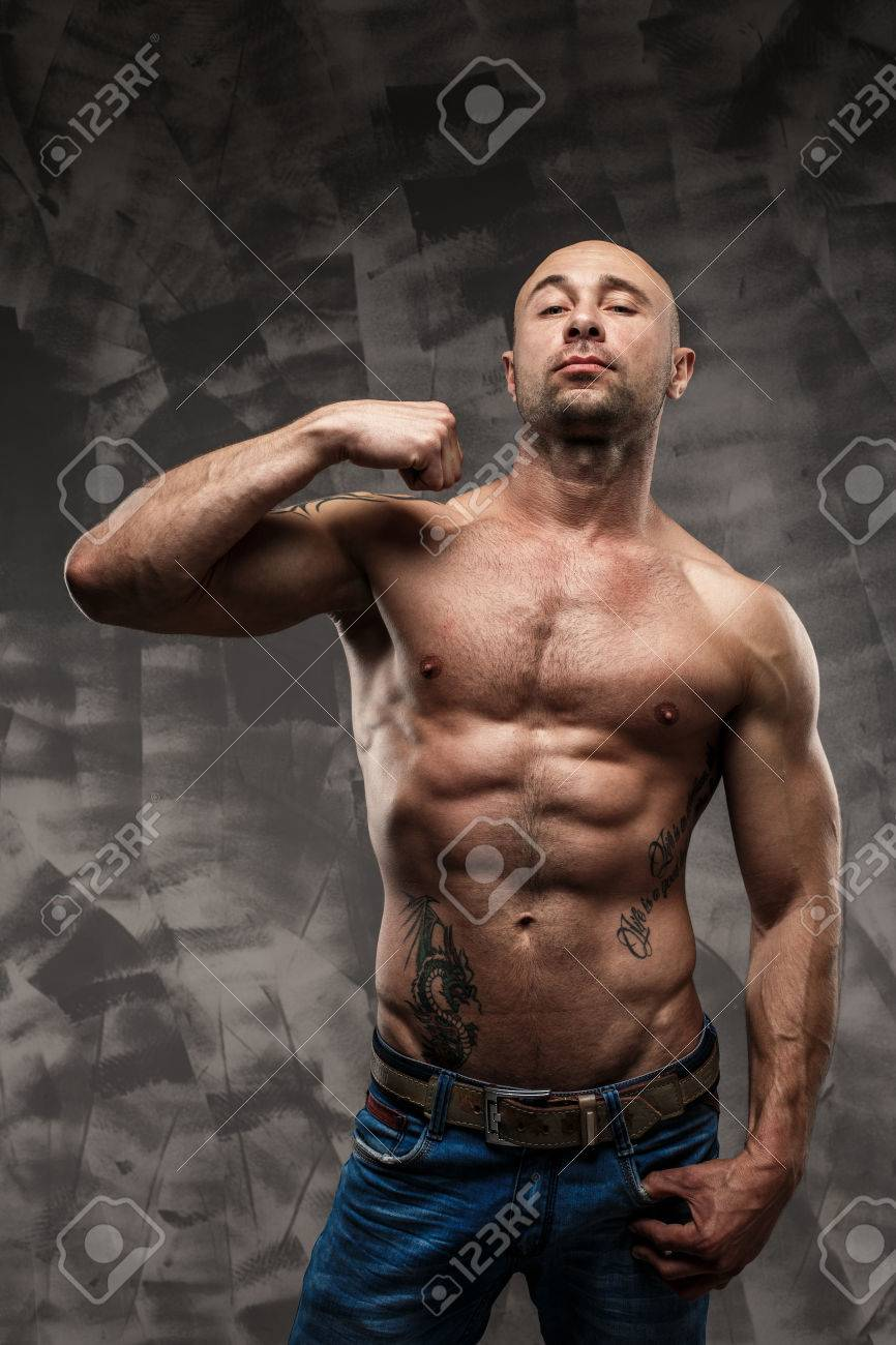 Shirtless muscled fitness man  Cool looking  Tough guy  Brown