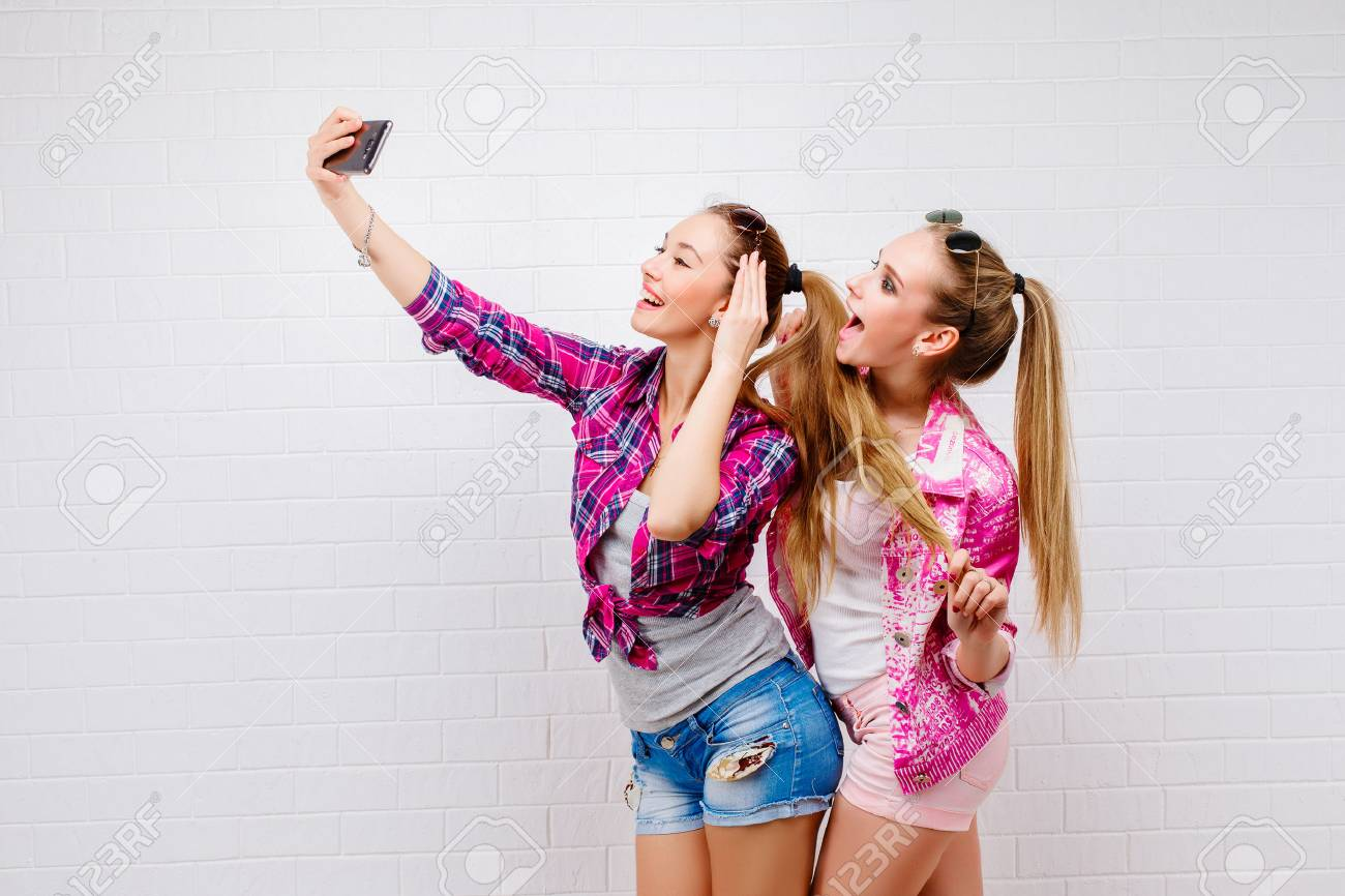 Young teen taking hot pics with friends