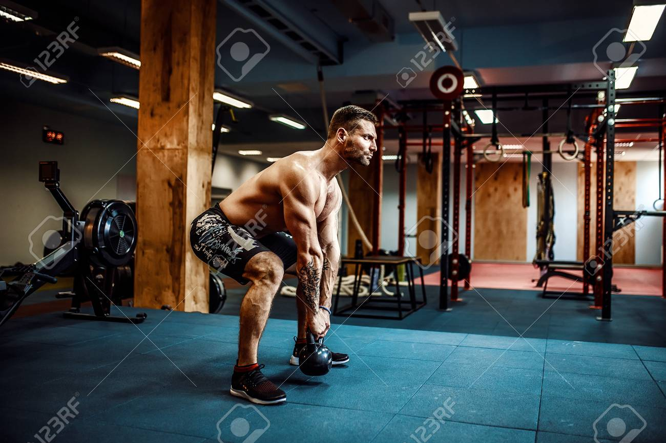 Fitness Kettlebells swing exercise bearded man workout at gym - 85335496