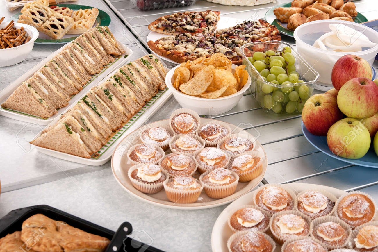 Food spread out over table in preparation of a picnic Stock Photo - 10483371