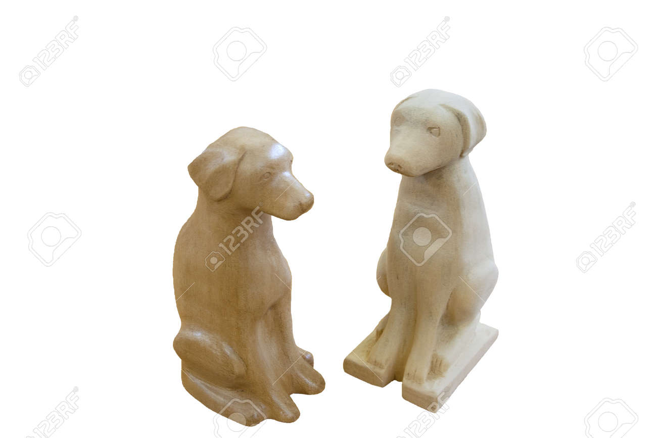 Carved wooden figures of dogs in stages of completion Stock Photo - 20720506
