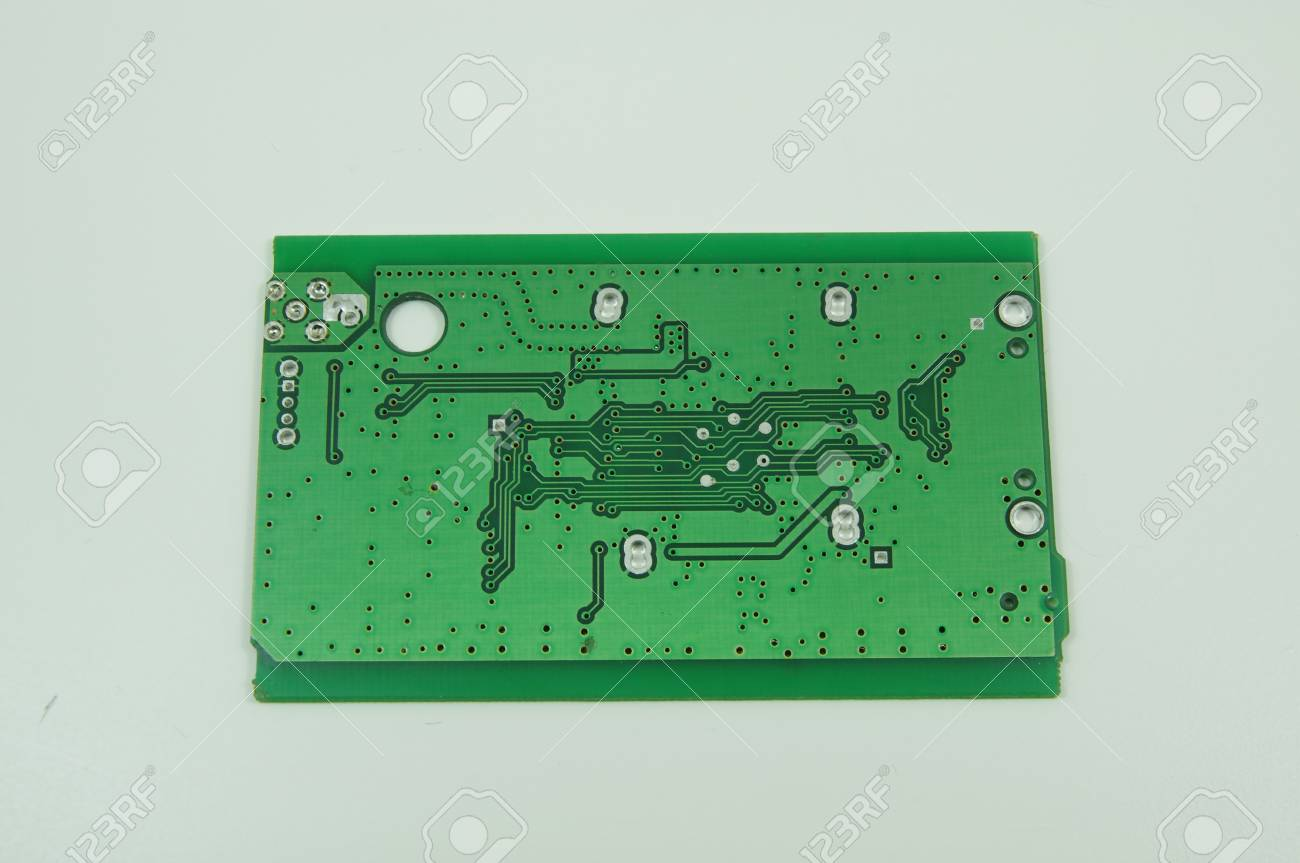 green printed circuit board pcb without any components soldered rh 123rf com Circuit Board Components Printed Circuit Board Mask