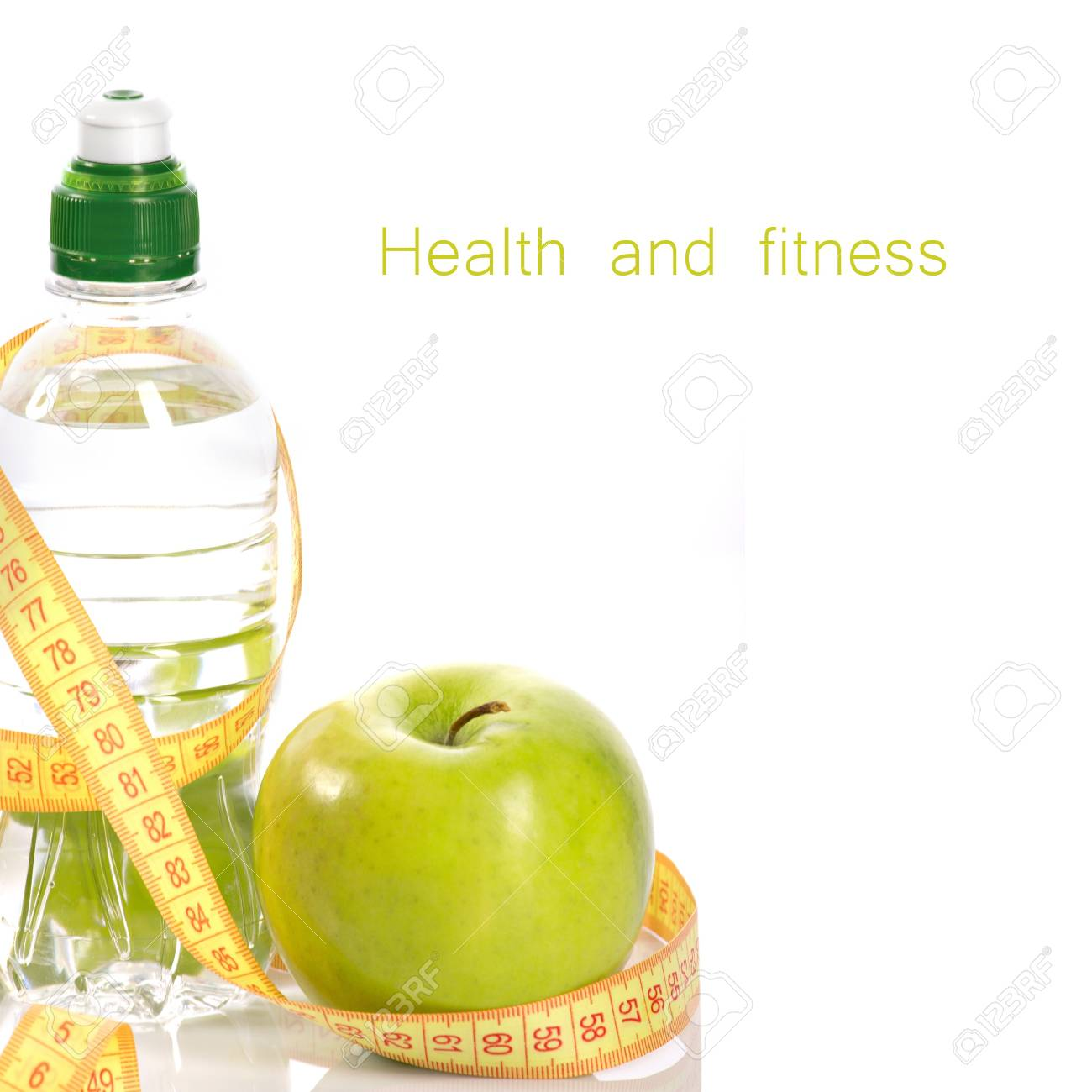Green apple, bottle with aqua and measure isolated on white Stock Photo - 14966760
