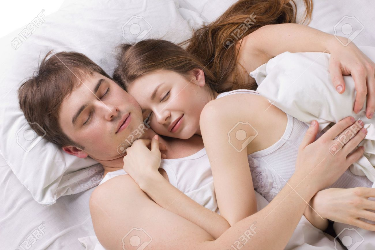 Young Husband And Wife Sleepping In White Beg Stock Photo Picture