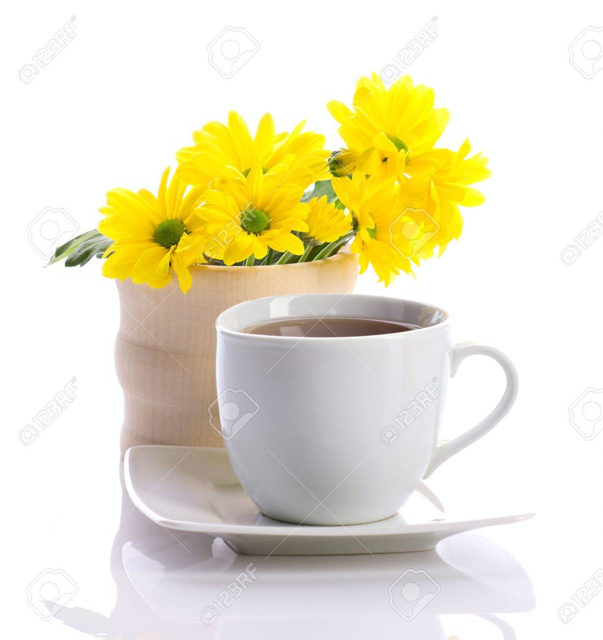 Tea In Whiite Cup And Yellow Flowers Isolated On White Stock Photo