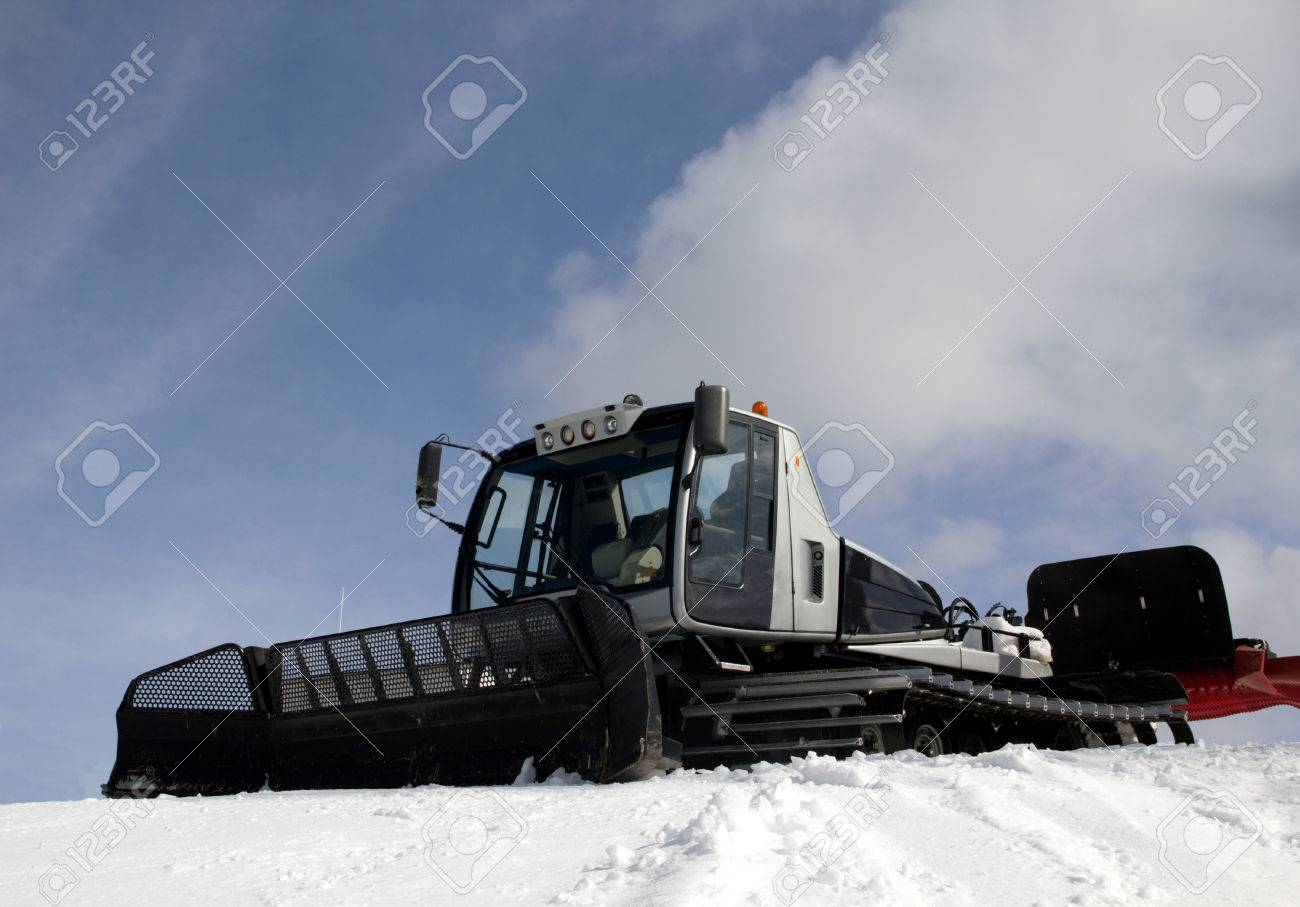 snow groomer on blue sky and clouds background Stock Photo - 26861548