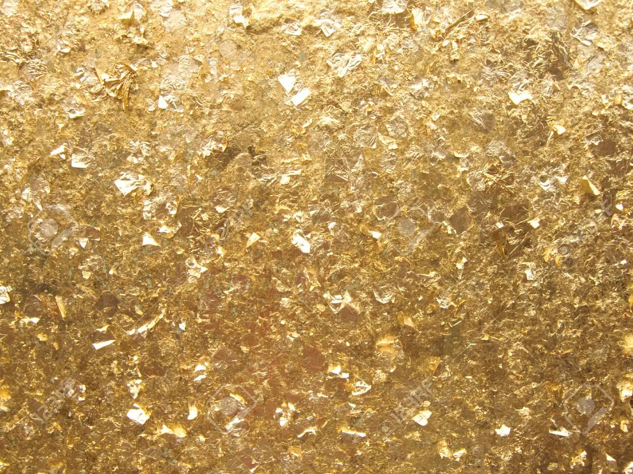 黄金背景、日光の金の葉のテクス...