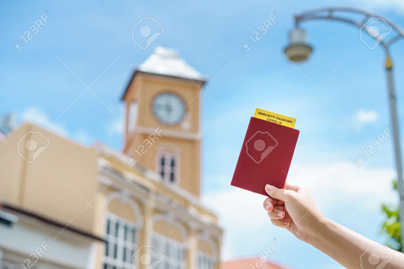 Passport with vaccination certificate for COVID-19 person record card. Immune passport or certificate for Get vaccinated before travel. Vaccination, disease immunity passport - 171394283
