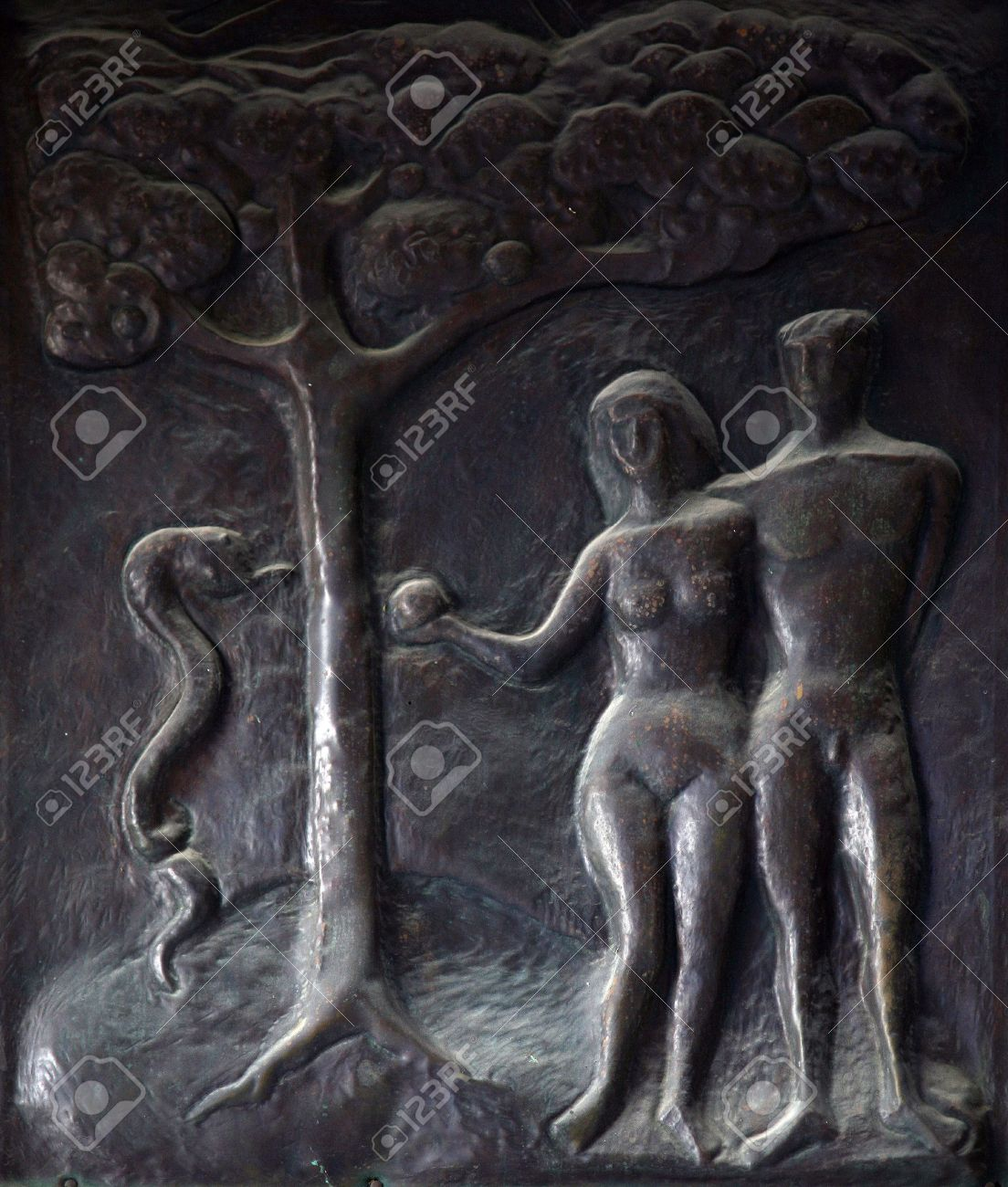 Adam and Eve, Illustrations of stories from the Bible on doors Basilica of the Annunciation in Nazareth Stock Photo - 10005058