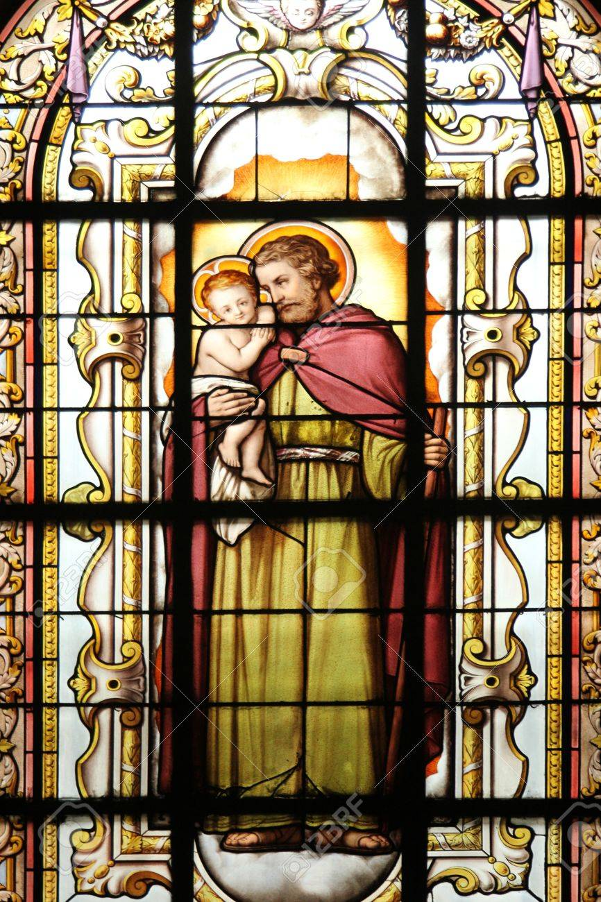 Saint Joseph holding baby Jesus, stained glass Stock Photo - 17402999