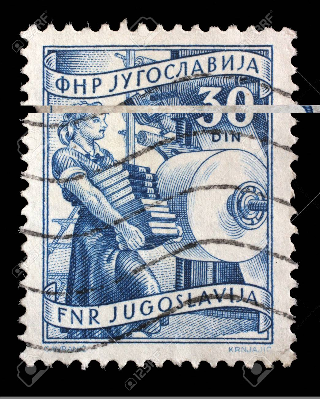 Stamp printed in Yugoslavia shows woman with books in publishing, domestic economy Series, circa 1952 - 59370184