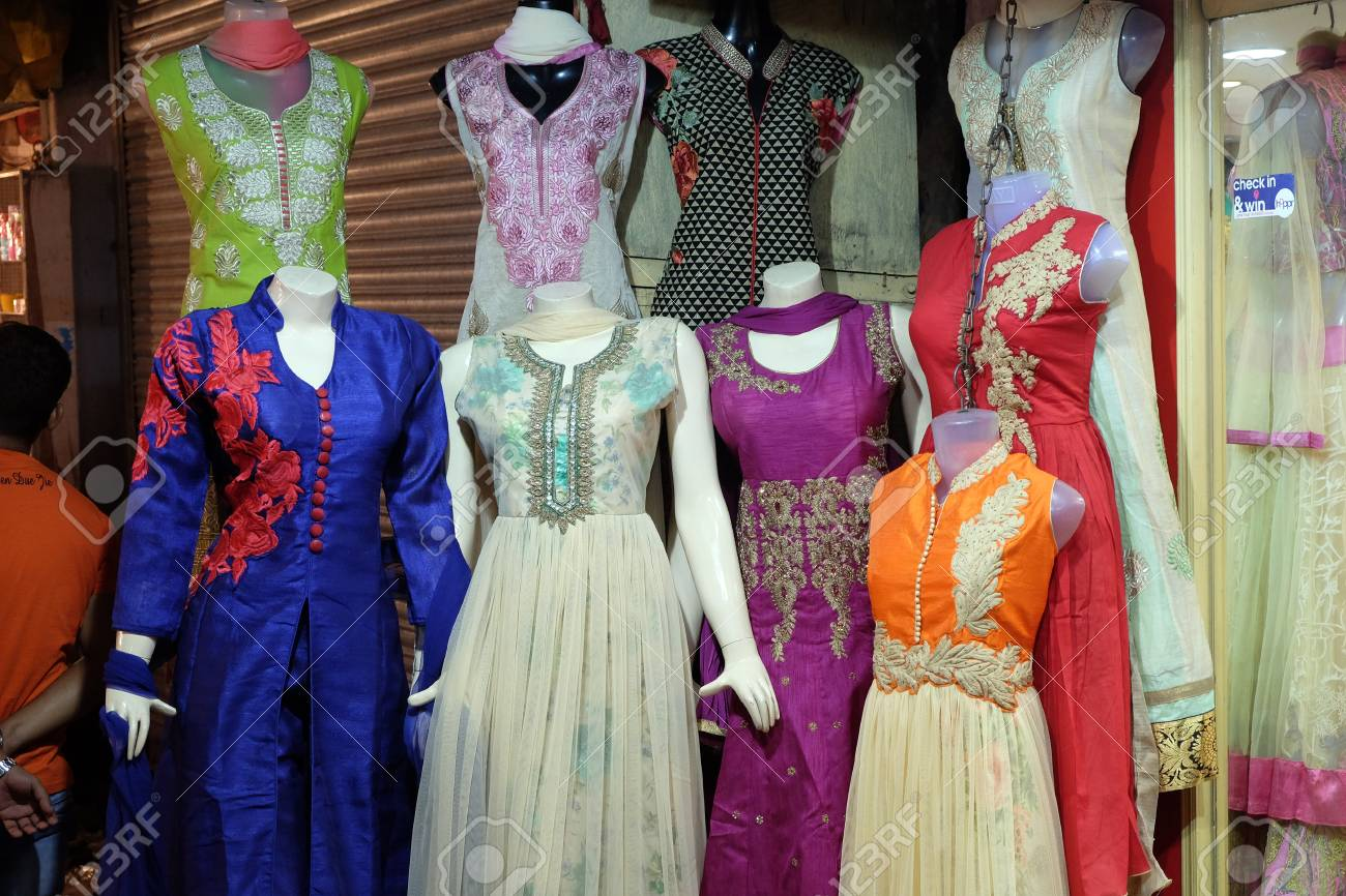 cfe5cbc6b4 Mannequins dressed in latest Indian dresses in front of a retail cloth shop  in Kolkata,