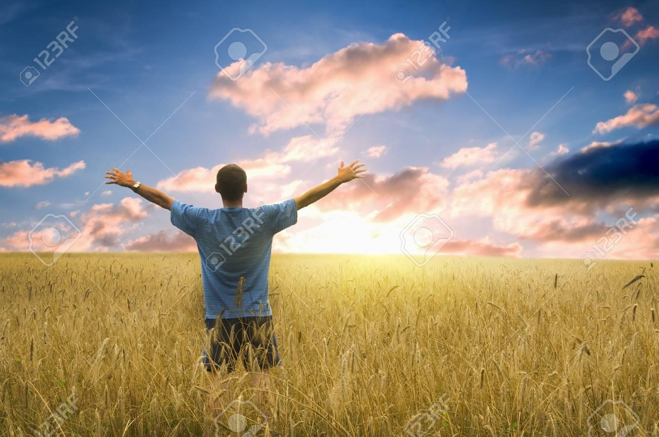 Man in yellow wheat meadow. Conceptual design. Stock Photo - 11604995
