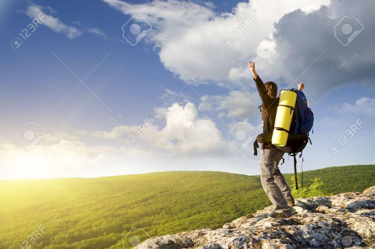 Man on top of mountain  Conceptual design Stock Photo - 12778765