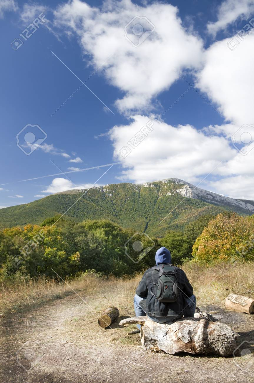 Man tourist in mountains forest. Leisure activity. Stock Photo - 11605176